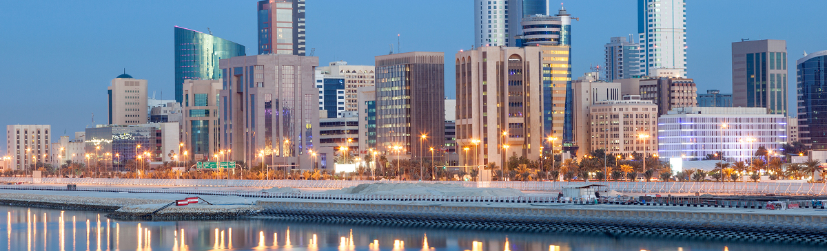 Skyline of Manama city illuminated at night. Kingdom of Bahrain Middle East